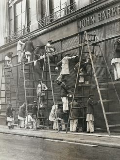 Group of painters on ladders