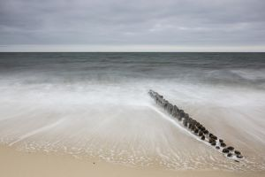 Groynes in the waves, Sylt, Schleswig-Holstein, Germany