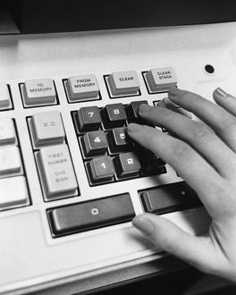 Hand using adding machine