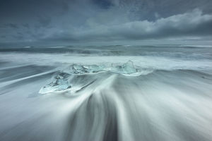 global landscape views/fred concha photography/ice rests beach off inlet jokulsarlon glacial