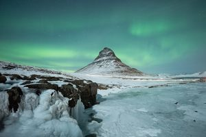 Kirkjufell winter Iceland under Aurora