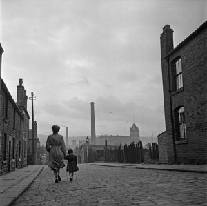 Lancashire Mill Town; Cotton mill worker Alice Nelson sets out for work at the Lilac