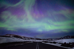 Northern lights over distant mountains in Iceland