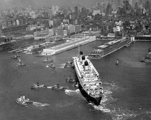 Ocean liner with tug boats in NY harbor