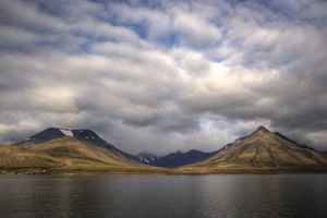 Picturesque Svalbard coastline fjord and mountains
