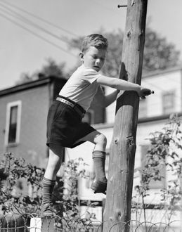 hulton archive/portrait boy playing outdoors