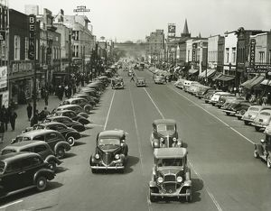 Retro style cars riding on street, (B&W), (Elevated view)