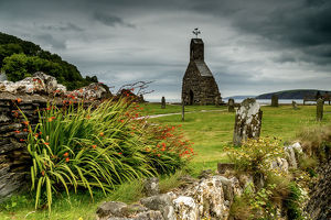 The ruins of St Brynach church at Cwm yr Eglwys on the Dinas Island peninsula between Newport