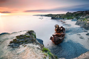 global landscape views/fred concha photography/rusty wreck beautiful beach vila nova milfontes