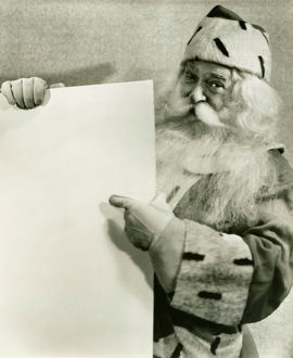 Santa Claus holding blank sheet of paper, (B&W), portrait