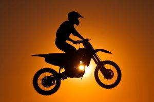 Silhouette of motocross at sunset