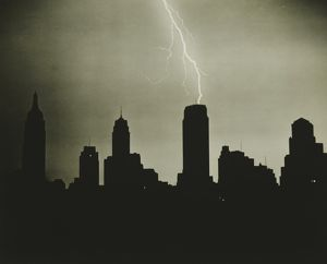 Silhouettes of skyscrapers and lightning on black sky, (B&W)