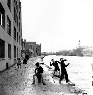 Skimming Stones; A group of children playing in the racially diverse dockland area