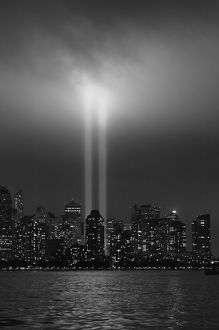 USA, New York City, Manhattan skyline with 9/11 memorial lights