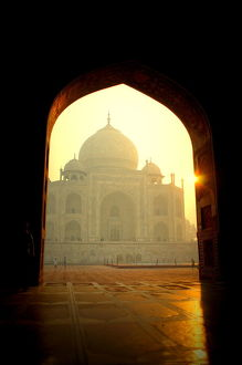 Taj Mahal at dawn through doorway
