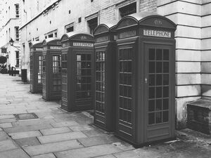 Telephone Booths In Row On Pavement