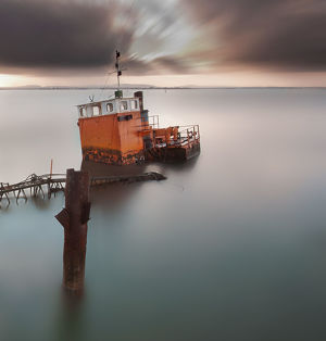 global landscape views/fred concha photography/tugboat abandoned tagus river lisbon