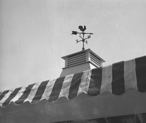 photographers/george marks photography/weather vane roof tower bw low angle view
