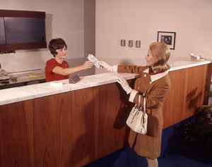 Woman Handing Deposit To Bank Teller Banking Women.