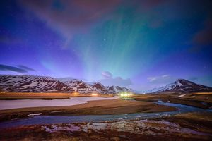 Wooden house on the background of the aurora in winter, Iceland