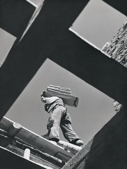 Worker carrying materials, seen from below