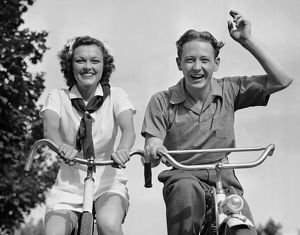 hulton archive/young couple riding bicycles